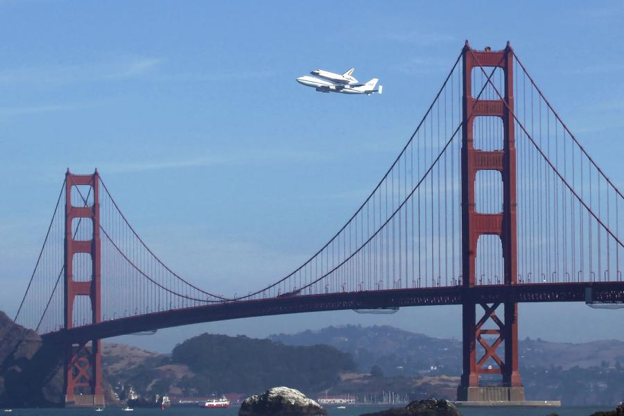 Space Shuttle Endeavour piggybacked on NASA 747 Flies Over Golden Gate Bridge