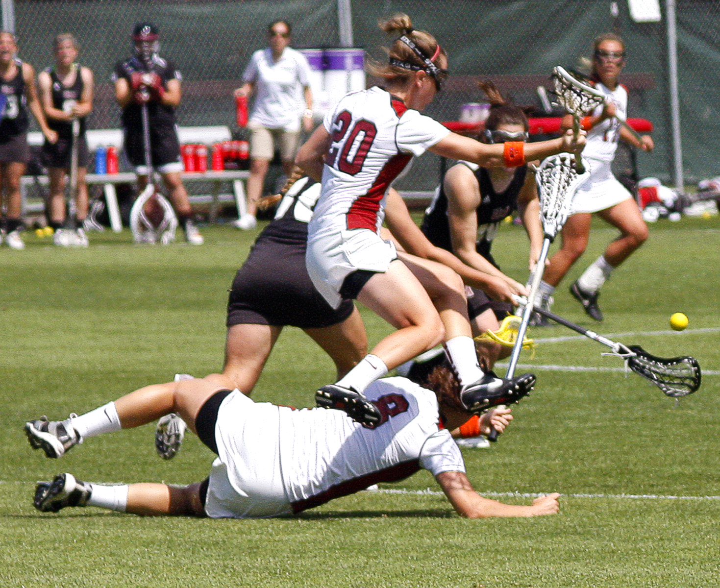 The Ladies don't fear contact pursuing the Ball in Lacrosse