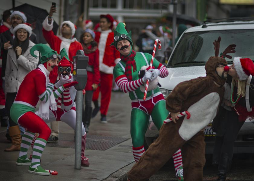 SantaCon San Francisco 2012 participants spreading cheer and goodwill