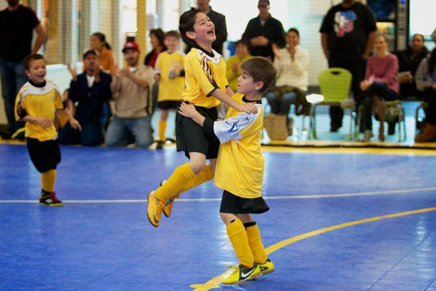 Victory! Teammates celebrate indoor soccer win.