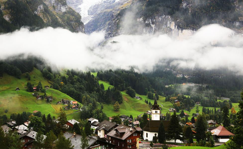 A Switzerland village in a foggy morning