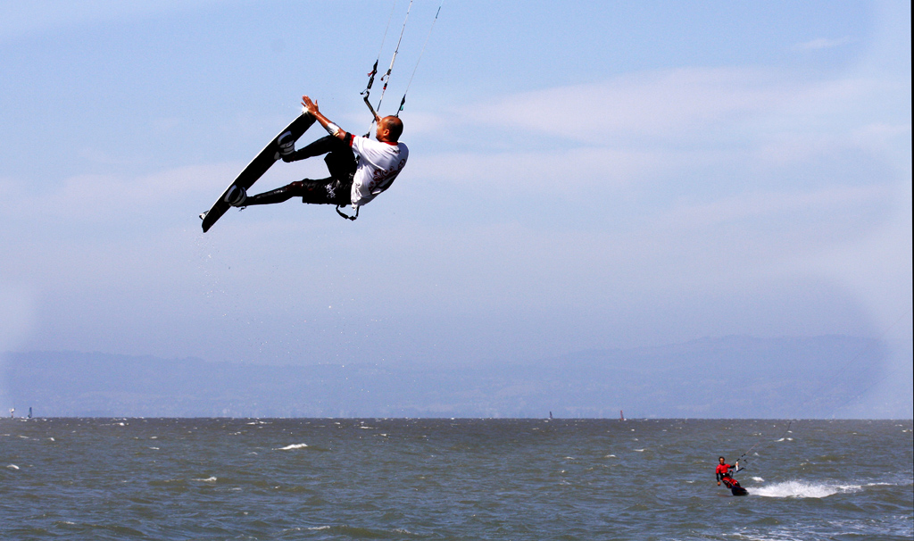 Kiteboarder soars high after Takeoff