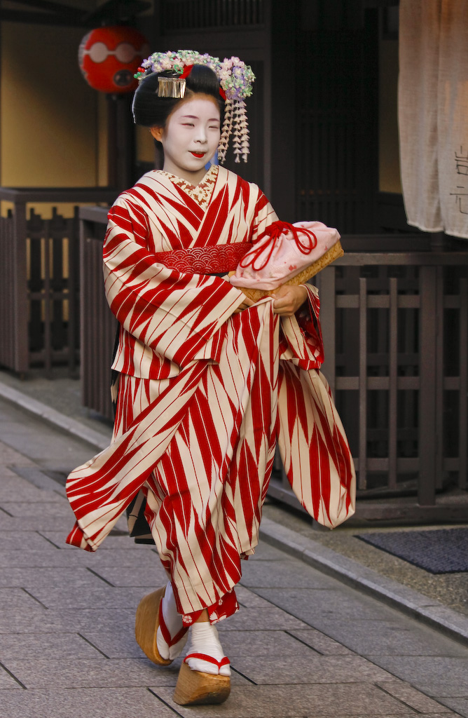 Apprentice Geisha hurrying off to her engagement, Kyoto, Japan