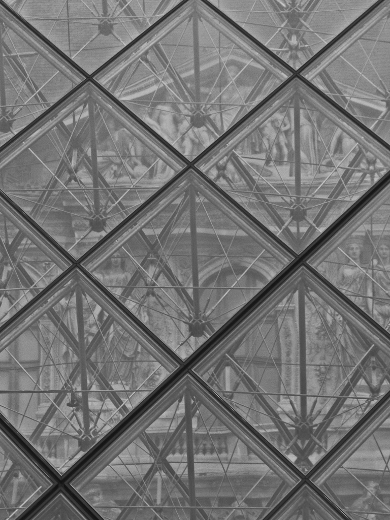 Seeing the Royal Musee du Louvre through the pyramid