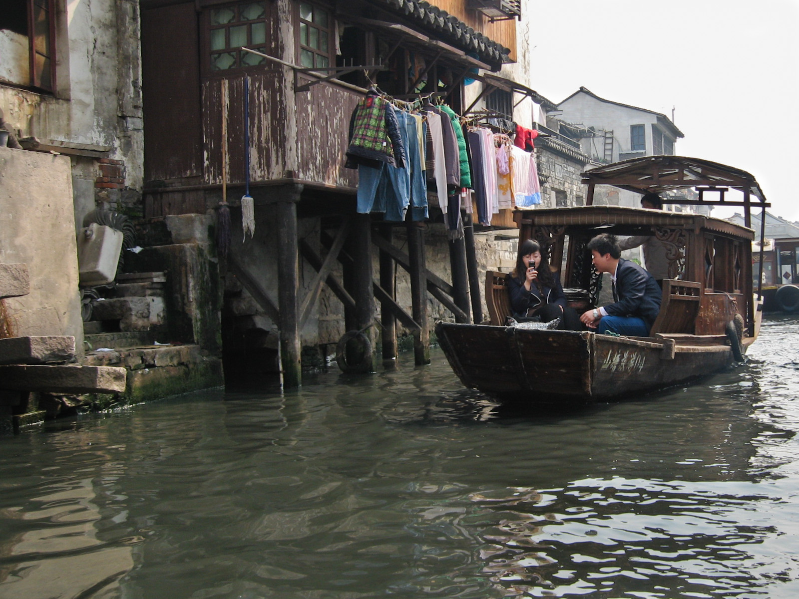 New World Meets Old World - Texting in Sampan in Suzhou China