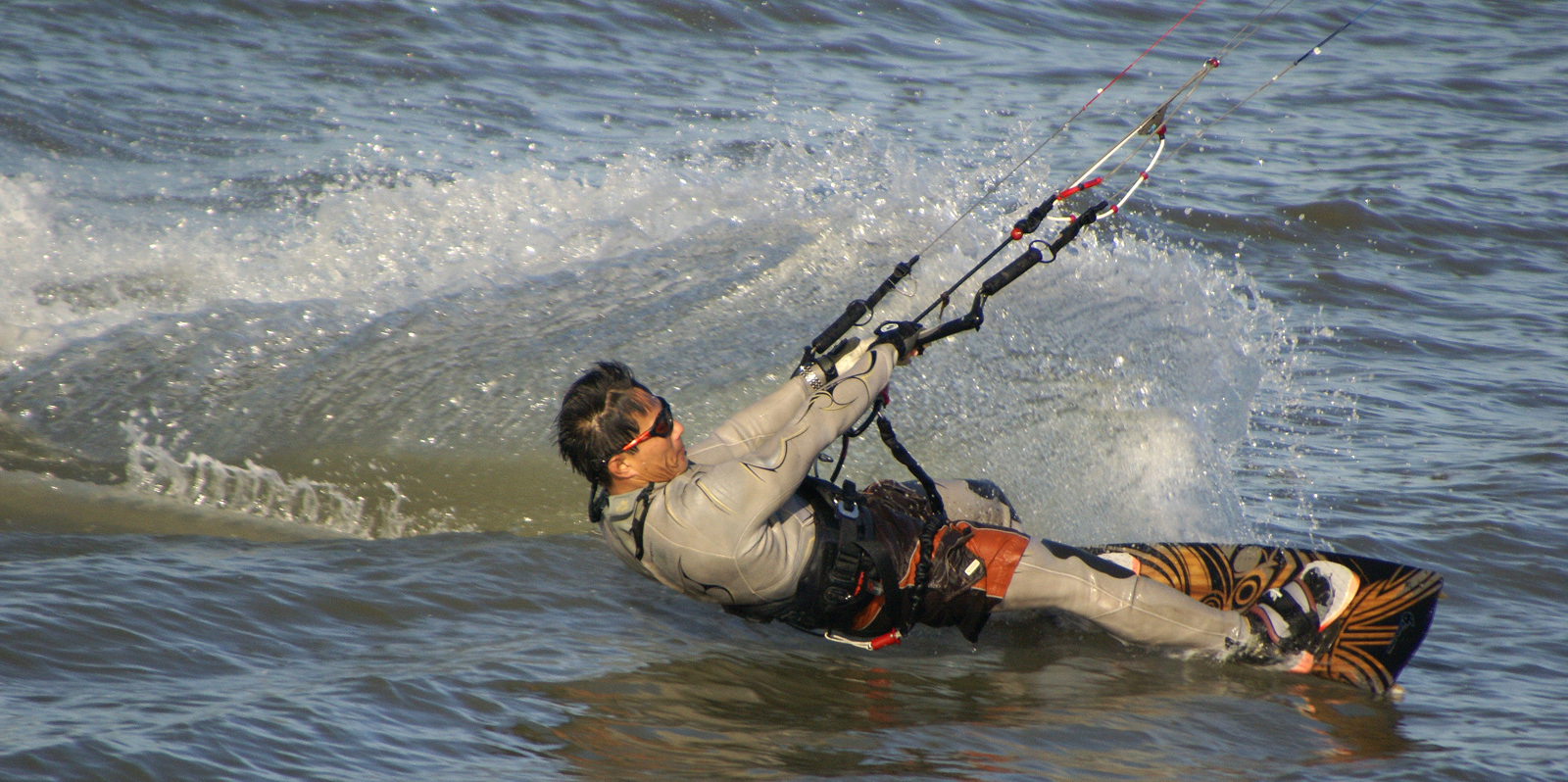 Kitesurfer pulls against kite
